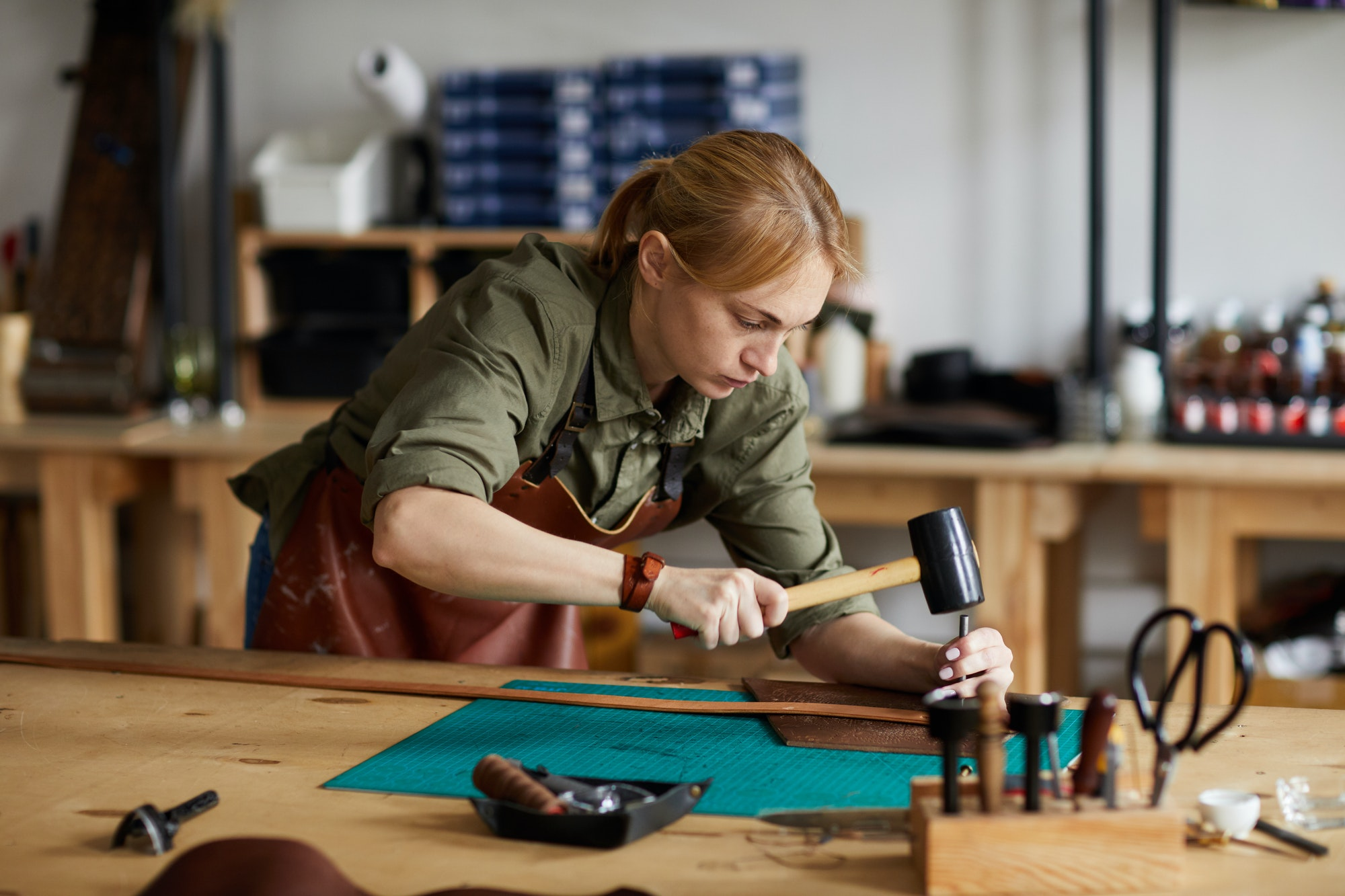 Female craftsman working in shop