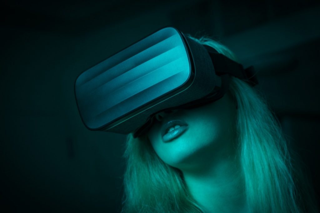 Girl with VR virtual reality 360 headset video gaming -- moody vibe with teal color